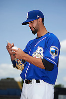 Biloxi Shuckers pitcher Jorge Lopez (28) signs autographs before a game against the Birmingham Barons on May 24, 2015 at Joe Davis Stadium in Huntsville, Alabama.  Birmingham defeated Biloxi 6-4 as the Shuckers are playing all games on the road, or neutral sites like their former home in Huntsville, until the teams new stadium is completed in early June.  (Mike Janes/Four Seam Images)
