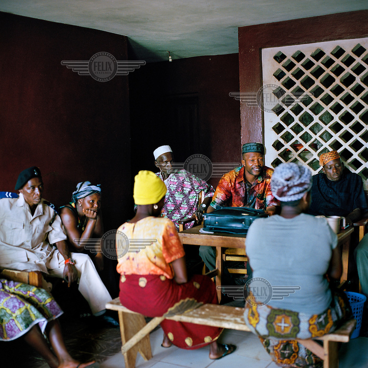 An informal 'chief's court', which does not have recognised legal juristiction, sits in a dedicated ground floor room in the house of a paramount chief in Makeni.