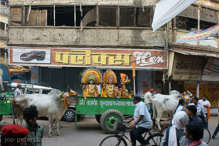 street scene in Varanasi . actors with masks in a devine parade re-enacting scenes of an old indian epos