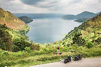 Photographer taking a photo of Lake Toba (Danau Toba), the largest volcanic lake in the world, North Sumatra, Indonesia