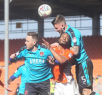 Blackpool's Nathan Delfouneso in action with Blackpool's Clark Robertson<br /> <br /> Photographer Mick Walker/CameraSport<br /> <br /> The EFL Sky Bet League One - Blackpool v Fleetwood Town - Saturday 14th April 2018 - Bloomfield Road - Blackpool<br /> <br /> World Copyright &copy; 2018 CameraSport. All rights reserved. 43 Linden Ave. Countesthorpe. Leicester. England. LE8 5PG - Tel: +44 (0) 116 277 4147 - admin@camerasport.com - www.camerasport.com