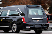 The casket of former President George H.W. Bush sits in a hearse in front of the U.S. Capitol, Wednesday, Dec. 5, 2018, in Washington. <br /> Credit: Shawn Thew / Pool via CNP