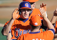 Kyle Parker is congratulated by teammates after scoring a run in the opening game of the 2008 season between the Mercer Bears and Clemson Tigers at Doug Kingsmore Stadium in Clemson, S.C. Photo by:  Tom Priddy/Four Seam Images