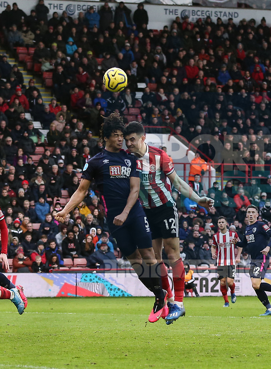 John Egan of Sheffield Utd and Nathan Ake of Bournemouth head the ball during the Premier League match at Bramall Lane, Sheffield. Picture date: 9th February 2020. Picture credit should read: Chloe Hudson/Sportimage