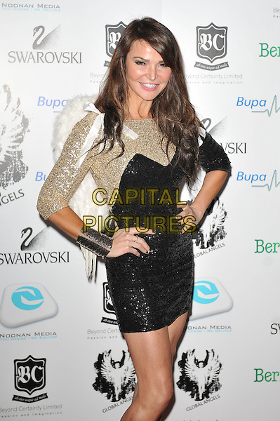 Lizzie Cundy.'Global Angels Awards', The Park Plaza Hotel, Westminster, London, England. 2nd December 2011..half length gold black dress sequined sequin sparkly mini hands on hips cuff .CAP/MAR.© Martin Harris/Capital Pictures.