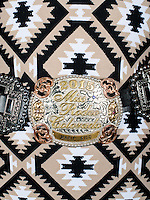 The belt buckle of Miss Rodeo Colorado 2015 winner Marie Kidd, from Avondale, Colorado, during the fashion show of the Miss Rodeo Colorado 2016 competition at the Greely Stampede in Greely, Colorado, July 1, 2015.<br /> <br /> Photo by Matt Nager