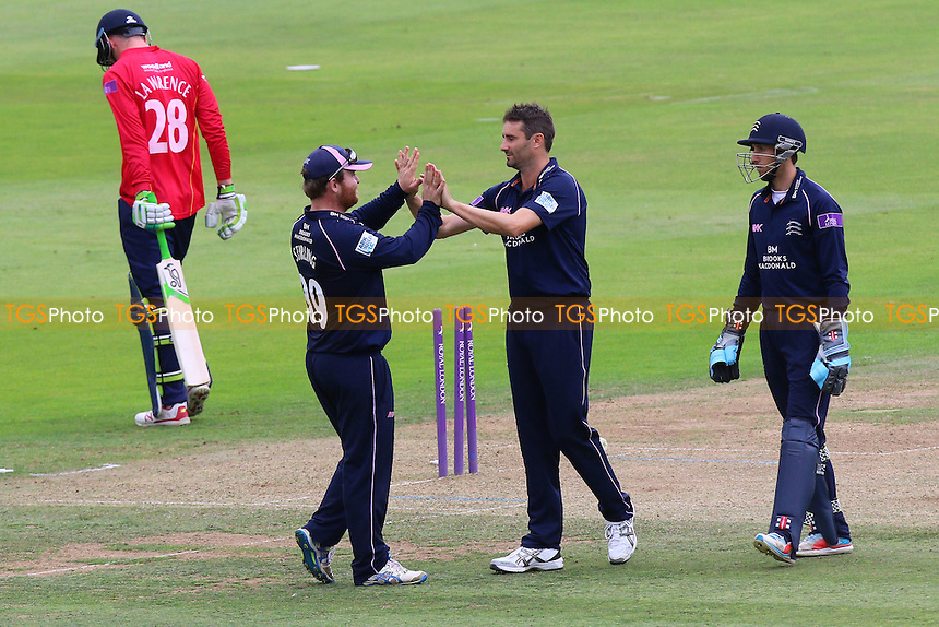 Tim Murtagh (C) of Middlesex is congratulated by his team mates after taking the wicket of Daniel Lawrence during Middlesex vs Essex Eagles, Royal London One-Day Cup Cricket at Lord's Cricket Ground on 31st July 2016