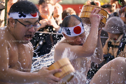 "January 10, 2015, Tokyo, Japan : Participants pour themselves cold water during the Annual New Year ice bath ceremony at Kanda Myojin Shinto. A group of 38 brave men a women wearing  only shorts or loincloths pour cold water over themselves in a traditional ""soul-purification"" ceremony to test their endurance, they believe would purify their souls and bring them good luck.  (Photo by Rodrigo Reyes Marin/AFLO)"