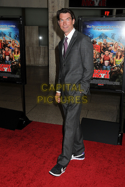 "Jerry O'Connell.Attending the ""Scary Movie 5"" Los Angeles film premiere held at the Cinerama Dome,  Hollywood, California, USA, .11th April 2013..full length grey gray suit hand in pocket purple tie trainers black .CAP/ADM/BP.©Byron Purvis/AdMedia/Capital Pictures"