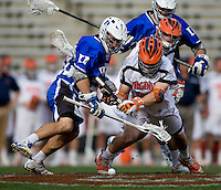 Brian McDermott (26) of Virginia fights for the face off with Terrence Molinari (30) of Duke during the ACC men's lacrosse tournament semifinals in College Park, MD.  Virginia defeated Duke, 16-12.