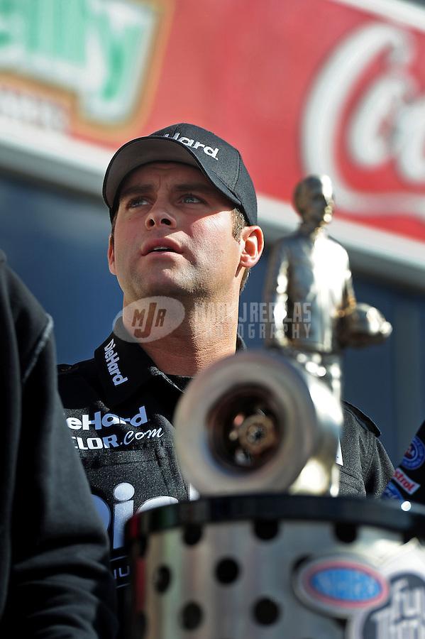 Nov. 13, 2011; Pomona, CA, USA; NHRA funny car driver Matt Hagan with the 2011 championship trophy during the Auto Club Finals at Auto Club Raceway at Pomona. Mandatory Credit: Mark J. Rebilas-.