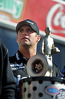 Nov. 13, 2011; Pomona, CA, USA; NHRA funny car driver Matt Hagan with the 2011 championship trophy during the Auto Club Finals at Auto Club Raceway at Pomona. Mandatory Credit: Mark J. Rebilas-.