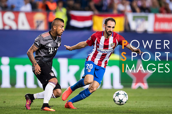 Juanfran of Atletico Madrid battles for the ball with Arturo Vidal of FC Bayern Munich during their 2016-17 UEFA Champions League match between Atletico Madrid vs FC Bayern Munich at the Vicente Calderon Stadium on 28 September 2016 in Madrid, Spain. Photo by Diego Gonzalez Souto / Power Sport Images