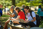 Ole Miss students catch up on their mobile devices between classes. Photo by Robert Jordan/Ole Miss Communications