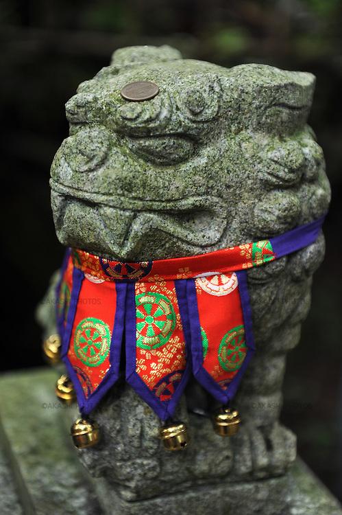 Komainu, guardian lion-dog in front of Iwaki Shrine.