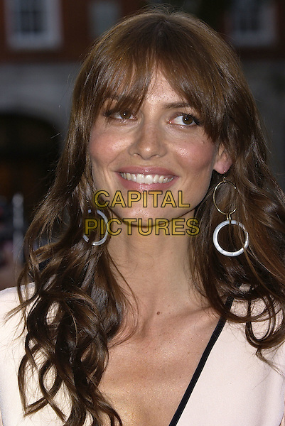 SAFFRON BURROWS.GQ Men of the Year Awards, Royal Opera House, London, 7th September 2004..portrait headshot hoop earrings.Ref: PL.www.capitalpictures.com.sales@capitalpictures.com.©Capital Pictures.