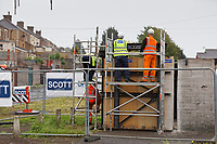 Pictured: Contractors prepare to move The Banksy. Wednesday 29 May 2019<br /> Re: Contractors are working to move Banksy's Season Greeting, now owned by John Brandler, which appeared on a garage wall in Port Talbot, to a new location in the same town in south Wales, UK.