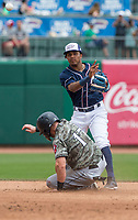 NWA Democrat-Gazette/BEN GOFF @NWABENGOFF<br /> Erick Mejia, Northwest Arkansas second baseman, throws to first to complete a double play in the 6th inning as Logan Taylor, Arkansas third baseman, slides in at second Wednesday, May 16, 2018, at Arvest Ballpark in Springdale.
