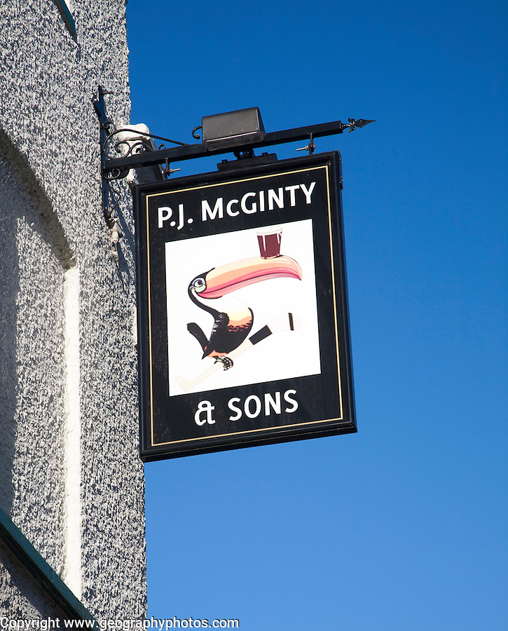 P.J McGinty Irish pub with toucan bird Guinness sign against blue sky, Ipswich, Suffolk, England