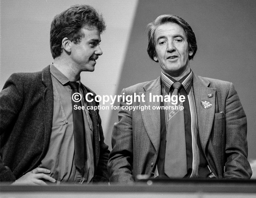 Dennis Skinner, MP, Labour Party, UK, talking with unknown person on the platform at 1984 annual conference in Blackpool. 19840174DS1.<br />
