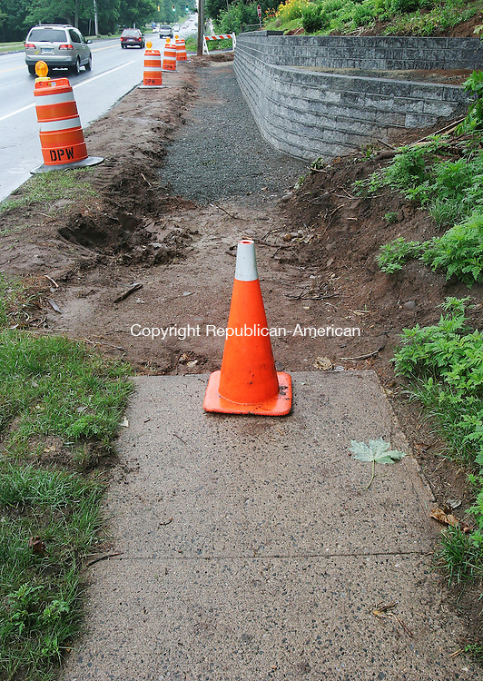 CHESHIRE, CT 08 July 2005 -070805BZ03-  Work has begun to improve road and sidewalk conditions  in Cheshire.  This area is on Rte. 10 across from the Cheshire Police Department.<br /> Jamison C. Bazinet Photo