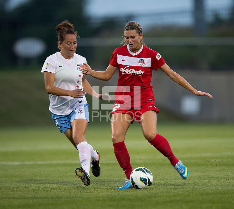 Stephanie Ochs (22) of the Washington Spirit passes the ball away from Jackie Santacaterina (18) of the Chicago Red Stars during a game at the Maryland SoccerPlex in Boyds, MD.