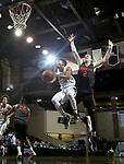 SIOUX FALLS, SD - MARCH 9:  Wes Stowers #4 from Marian takes the ball to the basket against Max Huber #2 from Indiana Tech during their second round game at the 2018 NAIA DII Men's Basketball Championship at the Sanford Pentagon in Sioux Falls. (Photo by Dave Eggen/Inertia)