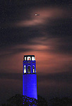 June full moon rose up over San Francisco Coit Tower which was lite in blue during the Golden State Warriors Championship series.