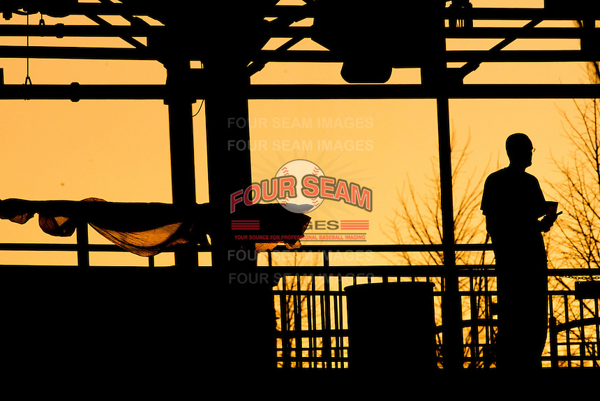 A fan watches from the main concourse during a game between the Purdue Boilermakers and the Missouri State Bears at Hammons Field on March 13, 2012 in Springfield, Missouri. (David Welker / Four Seam Images).