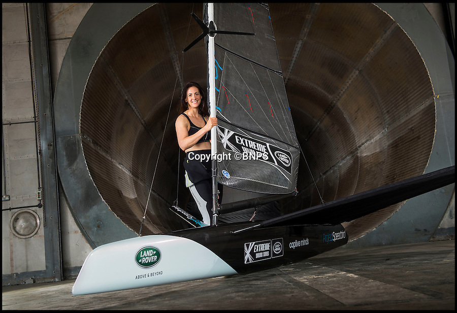 BNPS.co.uk (01202 558833)<br /> Pic: PhilYeomans/BNPS<br /> <br /> At 21lbs the carbon fibre hull is incredibly light.<br /> <br /> An adventurer is aiming to sail into the record books as the fastest woman on the water in a revolutionary boat so light she can carry it on her shoulder.<br /> <br /> Hannah White's cutting edge dinghy might be 18ft long but because it is built from space-age materials it weighs just 1.5 stones - the same as a toddler.<br /> <br /> Thanks to a state-of-the-art hydrofoil the specially designed vessel will 'hover' 3ft above the water with next to no drag, allowing it to hit speeds of almost 50mph.<br /> <br /> The current record stands at 34.74 knots - or 40mph - set by British windsurfer Zara Davis in 2006 and in order to break it White, 31, will have to average faster over a mile-long course.<br /> <br /> The boat, called Speedbird, was designed by former Royal Navy engineer David Chisholm, an expert in composites like carbon fibre, and built in a shed in Suffolk.