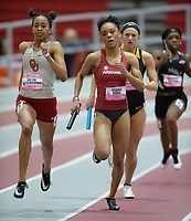 NWA Democrat-Gazette/ANDY SHUPE<br /> Arkansas' Sydney Davis (center) carries the baton Saturday, Feb. 9, 2019, during her leg of the 4x400 meters during the Tyson Invitational in the Randal Tyson Track Center in Fayetteville. Visit nwadg.com/photos to see more photographs from the meet.