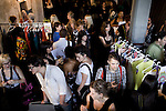 JOHANNESBURG, SOUTH AFRICA - MARCH 26: Buyers look at clothes after a fashion show at the South African fashion week on March 26, 2010, Turbine Hall in central Johannesburg, South Africa. Buyers and celebrities watched the 3 day fashion week, a biannual event. (Photo by Per-Anders Pettersson)