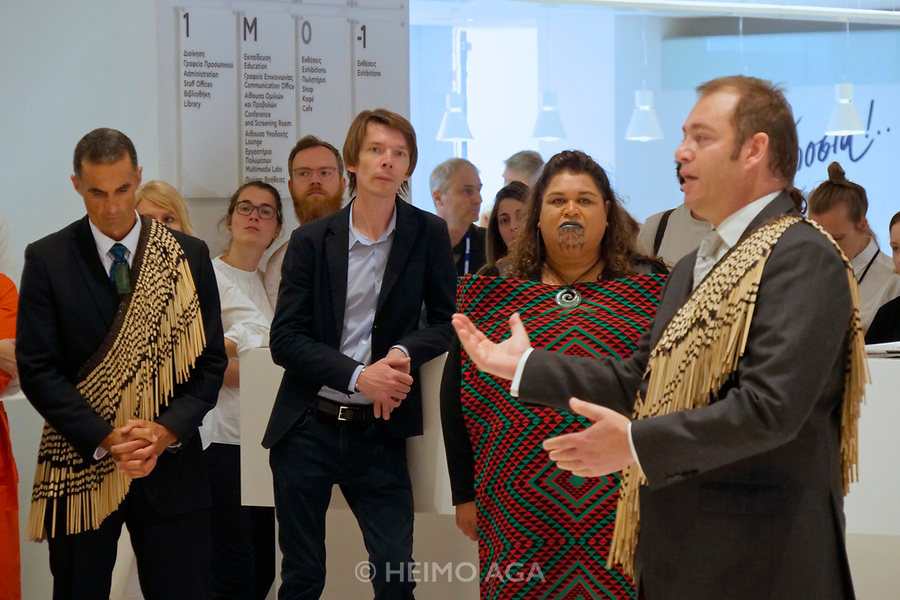 Athens, Greece. Opening days of documenta14.<br /> EMST, National Museum Of Contemporary Art. Chief Curator Adam Szymczyk (m.) watching a special welcoming ceremony by Maori artists from New Zealand.