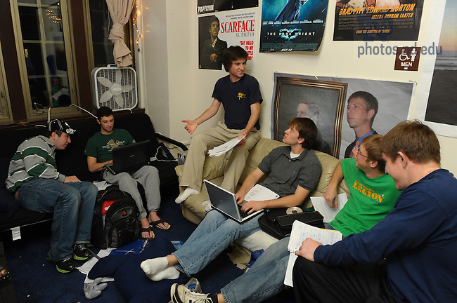 Resident Assistant (R.A.) Dan Krcmaric (center) in Dillon Hall..Photo by Matt Cashore/University of Notre Dame