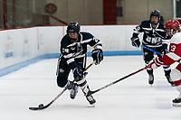 BOSTON, MA - FEBRUARY 16: Meghara McManus #24 of University of New Hampshire brings the puck forward during a game between University of New Hampshire and Boston University at Walter Brown Arena on February 16, 2020 in Boston, Massachusetts.