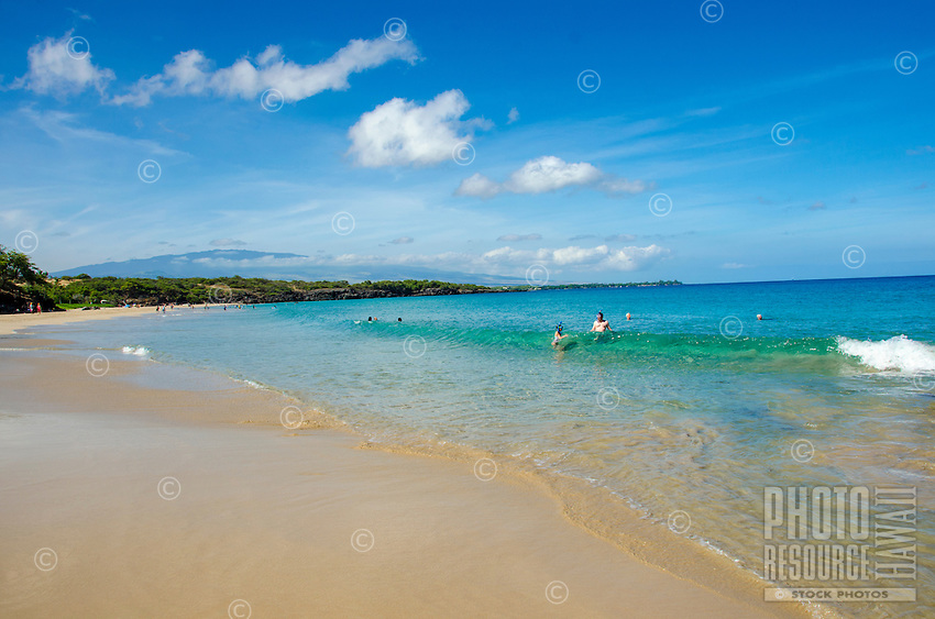 Snorkelers in the water at Hapuna Beach, along the Big Island's Kohala coastline. This white sand beach has been rated one of the best beaches in the world time and time again.