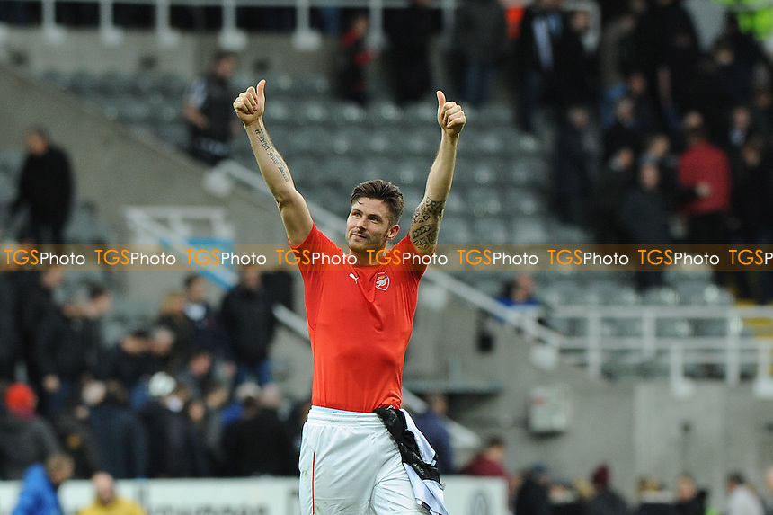 Olivier Giroud of Arsenal celebrates at the final whistle - Newcastle United vs Arsenal - Barclays Premier League Football at St James Park, Newcastle upon Tyne - 21/03/15 - MANDATORY CREDIT: Steven White/TGSPHOTO - Self billing applies where appropriate - contact@tgsphoto.co.uk - NO UNPAID USE