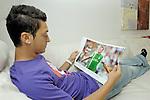FBL 2009/2010 - Werder Bremen - Interview mit Mesut &Ouml;zil (Oezil) 25.08.2009<br /> <br /> Interview mit Mesut &Ouml;zil (GER Werder Bremen #11) und  Homestory bei Mesut &Ouml;zil zu Hause in Bremen<br /> <br /> in einer ruhigen Minute sitzt oder liegt er entspannt auf dem Sofa und schautu sich Sportmagazine mit seinen Bildern an<br /> <br /> Foto &copy; nph ( nordphoto )