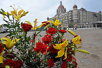 Flowers are left in remembrance in front of the Taj Mahal Hotel on the 1st of December, 2008, Mumbai, India.