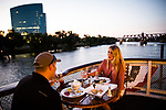 Sean Spagnoli, left, and Simone Juhl Hansen dine on the Delta King on the Sacramento River in Old Sacramento, California on August 15, 2015.