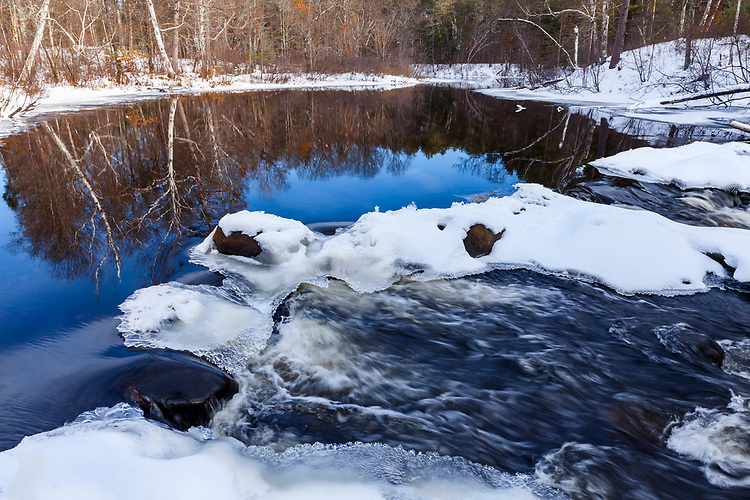 Morning light on ice formations and reflections on the Manitowish River; Vilas County, WI