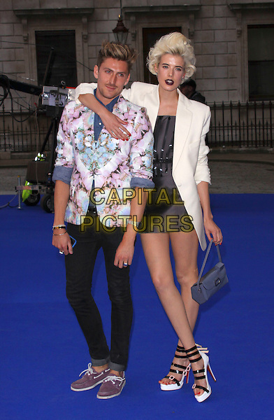 HENRY HOLLAND & AGYNESS DEYN .Royal Academy of Arts Summer Exhibition Preview Party at the Royal Academy, Piccadilly, London, England. June 3rd, 2009..full length white boyfriend blazer jacket hand on hip blue bag handbag black dress christian louboutin shoes sandals buckles strappy platform hand arm around shoulder print jacket skinny jeans trainers .CAP/AH.©Adam Houghton/Capital Pictures