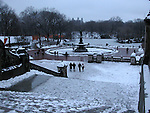Four people walking towards pond in Central park in the snow. Images of New York 2004, New York,U.S.A
