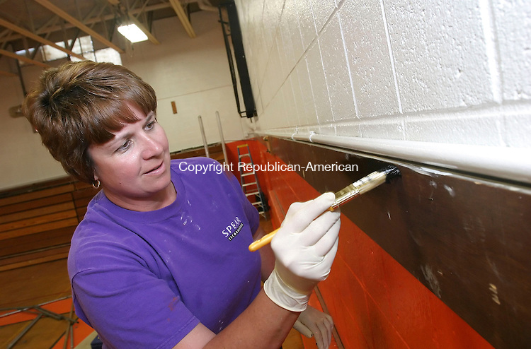 WATERTOWN, CT 6/28/07- 062807BZ05- Karen Blake, co-chair of Project PRIDE, paints the trim around the walls of the Watertown High School gymnasium Thursday afternoon.  Blake and co-chair MaryEllen Farese coordinated more than 20 volunteer painters to completely refinish the gym.  In addition to painting the group also raised money to purchase  new banners, plaques and padding for the walls.<br /> Jamison C. Bazinet Republican-American