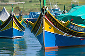 Traditional wooden fishing boats called Luzzu in Marsaxlokk, Malta