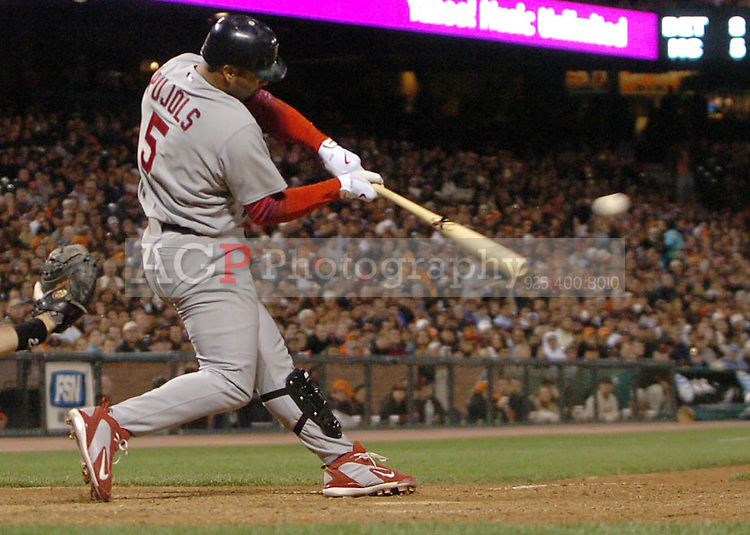 Albert Pujols of the St. Louis Cardinals hits a single in the seventh inning against the San Francisco Giants during the seventh inning at At&T Park in San Francisco Tuesday May 23, 2006. (Alan Greth/Contra Costa Times)
