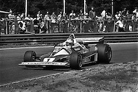 HEUSDEN-ZOLDER, BELGIUM - May 16: Niki Lauda of Austria drives the Ferrari 312T2 026/Ferrari 015 en route to victory in the Grand Prix of Belgium FIA Formula 1 race at Circuit Zolder near Heusden-Zolder, Belgium on May 16, 1976.