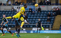 Chey Dunkley of Oxford United wins the ball in the air during the Sky Bet League 2 match between Wycombe Wanderers and Oxford United at Adams Park, High Wycombe, England on 19 December 2015. Photo by Andy Rowland.