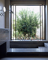 The large window beside the sunken bath in this bathroom opens onto a private courtyard