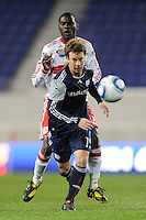 Zack Schilawski (15) of the New England Revolution chases down a ball. The New York Red Bulls defeated the New England Revolution 3-0 during a U. S. Open Cup qualifier round match at Red Bull Arena in Harrison, NJ, on May 12, 2010.